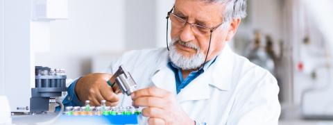 Man in laboratory performing chemical test