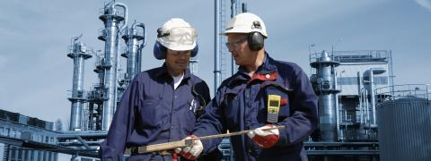 Explosion safety two inspectors at an industrial site
